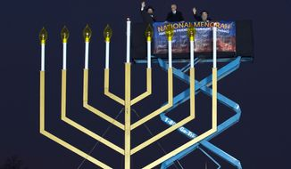 From left, Rabbi Levi Shemtov, White House Chief of Staff Denis McDonough and Rabbi Abraham Shemtov participate in the annual National Menorah Lighting in celebration of Hanukkah on the Ellipse near the White House in Washington, Sunday, Dec. 6, 2015. (AP Photo/Jose Luis Magana)