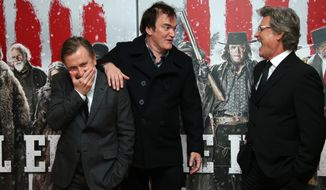 From left, Tim Roth, Quentin Tarantino and Kurt Russell pose for photographers upon arrival at the premiere of the film 'The Hateful Eight' in London, Thursday, Dec. 10, 2015. (Photo by Joel Ryan/Invision/AP)