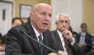 House Ways and Means Committee Chairman Rep. Kevin Brady, R-Texas, joined by Rep. Dave Reichert, R-Wash., right, appears on Capitol Hill in Washington, Thursday, Dec. 10, 2015, before the House Rules Committee. (AP Photo/J. Scott Applewhite) ** FILE **