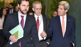 US Secretary of State John Kerry, right, walks with White House senior advisor Brian Deese, left, and US Special Envoy for Climate Change Todd Stern, centre, to attend a meeting with French Foreign Minister  Laurent Fabius during the COP 21 United Nations conference on climate change at Le Bourget, on the outskirts of Paris, on Thursday  Dec. 10, 2015. (Mandel Ngan Pool via AP)