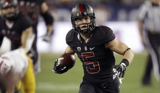 FILE - In this Dec. 5, 2015, file photo, Stanford's Christian McCaffrey runs against Southern California during the first quarter of a Pac-12 Conference championship NCAA college football game in Santa Clara, Calif. McCaffrey celebrated with his teammates when he heard the news he was one three finalists for the Heisman Trophy, and quickly deflected the credit to his offensive line, other teammates and coaches. Stanford's do-it-all running back earned his trip to New York by being a tough between-the-tackles force, a dynamic returner, a lightning quick runner and a matchup nightmare as a receiver.  (AP Photo/Ben Margot, File)