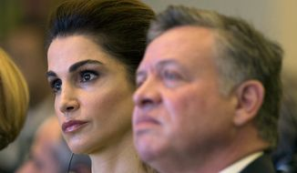 King Abdullah II of Jordan, right, and his wife Queen Rania sit during the Mediterranean Dialogues Conference Forum, in Rome, Thursday, Dec. 10, 2015. (AP Photo/Andrew Medichini) ** FILE **