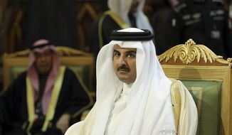Qatar Emir Sheik Tamim bin Hamad Al-Thani, center, attends the closing session of the 36th Gulf Cooperation Council Summit in Riyadh, Saudi Arabia, Thursday, Dec. 10, 2015. (AP Photo/Khalid Mohammed)