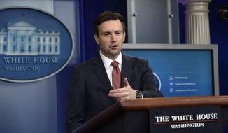 White House press secretary Josh Earnest speaks during the daily briefing at the White House in Washington, Thursday, Dec. 10, 2015. Earnest answered questions about the visa program, the newly signed education bill, the transportation bill and other topics. (AP Photo/Susan Walsh)
