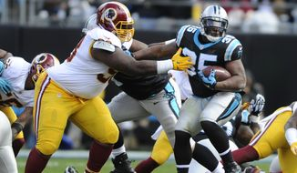 "FILE - In this Nov. 22, 2015 file photo, Carolina Panthers' Jonathan Stewart (28) tries to run past Washington Redskins' Terrance Knighton (98) in the first half of an NFL football game in Charlotte, N.C. Only six NFL teams have sacked opposing quarterbacks less often than the Washington Redskins, and coach Jay Gruden acknowledges: ""As a group, we do have to get better.""  (AP Photo/Mike McCarn, File)"