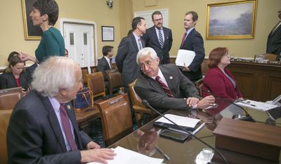 House Ways and Means Committee member Rep. Dave Reichert, R-Wash., center, confers with the committee's ranking member Rep. Sander Levin, D-Mich., on Capitol Hill in Washington, Thursday, Dec. 10, 2015, prior to going before the House Rules Committee as Congress works on legislation to avert a government shutdown when the funding runs out Friday night at midnight. White House and congressional negotiators are searching for compromise on huge tax and spending bills with a combined price tag of well over $1 trillion, with leaders hoping to clinch agreements and let Congress adjourn next week for the year. Ways and Means is the chief tax-writing committee in the House of Representatives. (AP Photo/J. Scott Applewhite) **FILE**