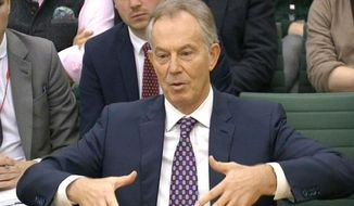 In this image taken from TV, former British Prime Minister Tony Blair gestures while appearing in front of the Foreign Affairs Select Committee at the House of Commons in London on Friday Dec. 11, 2015, where he is giving evidence on Britain's foreign policy towards Libya. (PA via AP) ** FILE **