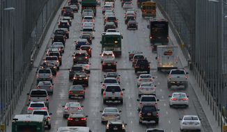 Vehicles make their way westbound on Interstate 80 across the San Francisco-Oakland Bay Bridge as a new series of rain storms bear down on the Bay Area Thursday, Dec. 10, 2015, as seen from Treasure Island in San Francisco. (AP Photo/Ben Margot)