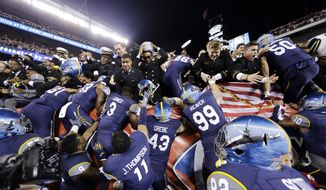 Navy players climb into the stands after winning an NCAA college football game against Army, 21-17, Saturday, Dec. 12, 2015, in Philadelphia. (AP Photo/Matt Rourke)