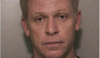 Breen Peck, 52, an air traffic controller, was arrested in Long Island Wednesday on illegal weapons and drug charges. (Image: Nassau County Police Department)