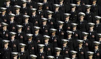 Navy Midshipmen march onto the field before an NCAA college football game against Army, Saturday, Dec. 12, 2015, in Philadelphia. (AP Photo/Matt Rourke) **FILE**