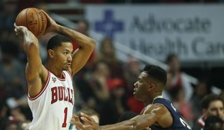 Chicago Bulls guard Derrick Rose (1) looks to pass the ball against New Orleans Pelicans guard Norris Cole during the first half of an NBA basketball game, Saturday, Dec. 12, 2015, in Chicago. (AP Photo/Kamil Krzaczynski)