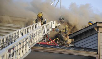 Firefighters work on a fire at the Annapolis Yacht Club in Annapolis, Md., on Saturday, Dec. 12, 2015. (Matthew Cole/Capital Gazette via AP) MANDATORY CREDIT