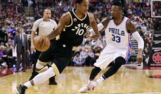 Toronto Raptors' DeMar DeRozan, left, drives past Philadelphia 76ers' Robert Covington during first half of an NBA basketball game in Toronto, Sunday, Dec. 13, 2015. (Frank Gunn/The Canadian Press via AP) MANDATORY CREDIT