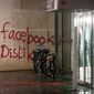 """In this Dec. 12,  2015 picture bicycles stand next to a destroyed  entrance of  a building that was attacked  in Hamburg , northern Germany.  Police say they are looking for a group of up to 20 people who wrote """"Facebook Dislike"""" on the social media firm's German headquarters in Hamburg. The unidentified group of people also threw paint bombs and damaged doors and windows at the American company's building in Hamburg's Neustadt neighborhood.  (Bodo Marks/dpa via AP)"""