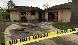 An abandoned house where multiple people died early Sunday, Dec. 13, 2015 in Fresno, Calif., is seen after flames were extinguished. The Fresno Fire Department says fire crews brought several people out of the boarded-up home. (Paul Schlesinger/The Fresno Bee via AP)   LOCAL PRINT OUT (VISALIA TIMES-DELTA, REEDY EXPONENT, KINGBURG RECORDER, SELMA ENTERPRISE, HANFORD SENTINEL, PORTERVILLE RECORDER, MADERA TRIBUNE, THE BUSINESS JOURNAL FRENSO); LOCAL STATIONS OUT (KSEE24, KFSN30, KGE47, KMPH26)