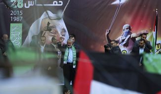 Palestinian top Hamas leader Ismail Haniyeh waves to supporters during a rally to commemorate the 28th anniversary of the Hamas militant group, at the main road in Gaza City, Monday, Dec. 14, 2015.  (AP Photo/Adel Hana)