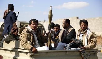 Tribesmen loyal to Shiite, known as Houthis, ride on a pickup truck as they attend a tribal gathering showing support for the Houthi movement in Sanaa, Yemen, Monday, Dec. 14, 2015. (AP Photo/Hani Mohammed)