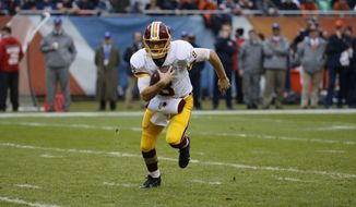 Washington Redskins quarterback Kirk Cousins (8) runs to the end zone for a touchdown during the first half of an NFL football game against the Chicago Bears, Sunday, Dec. 13, 2015, in Chicago. (AP Photo/Charles Rex Arbogast)