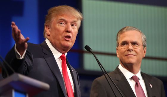 Republican presidential candidates Donald Trump and Jeb Bush participate in the first Republican presidential debate at the Quicken Loans Arena in Cleveland on Aug. 6, 2015. (Associated Press) **FILE**