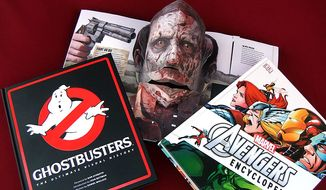 Zadzooks' gift ideas for pop culture readers includes Ghostbusters: The Ultimate Visual History, The Walking Dead: The Popup Book and Marvel's The Avengers Encyclopedia. (Photograph by Joseph Szadkowski / The Washington Times)