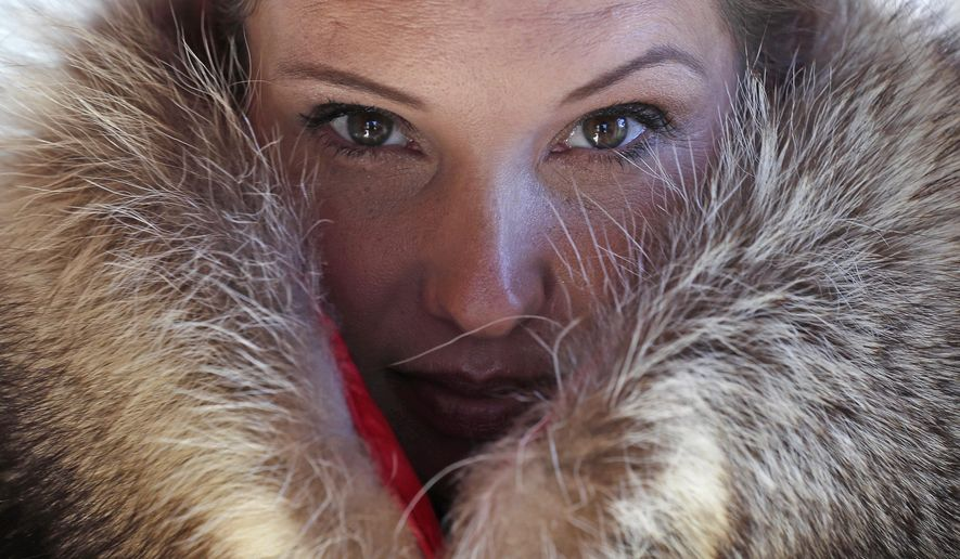 pam paquin poses with a roadkill fur