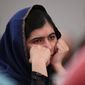 """Nobel Prize winner Malala Yousafzai listens to eyewitness accounts of the Taliban attack on the Army Public School in Peshawar, Pakistan, which took place on Dec. 16, 2014, and killed 150 people, as she attends the """"Poppies for Peace in Peshawar"""" event in Birmingham, central England, Tuesday Dec. 15, 2015. The 18-year-old said comments such as those by controversial United States presidential hopeful Donald Trump could """"radicalize more terrorists"""" and urged politicians to think carefully before speaking. (Joe Giddens/PA via AP)"""
