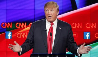 """""""People like what I say, people respect what I say,"""" Donald Trump said, kicking off the prime-time debate in Las Vegas, sponsored by CNN. (Associated Press)"""