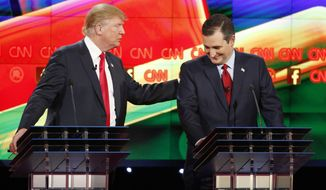 Donald Trump, left, and Ted Cruz joke about remarks Cruz has made about Trump's temperament during the CNN Republican presidential debate at the Venetian Hotel & Casino on Tuesday, Dec. 15, 2015, in Las Vegas. (AP Photo/John Locher) ** FILE **
