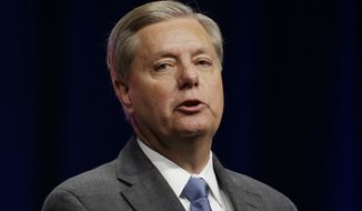 """I blame Obama for [the Islamic State], not Bush,"" Sen. Lindsey Graham said in the Republican undercard debate Tuesday in Las Vegas. ""I am tired of beating on Bush, I miss George W. Bush. I wish he were president right now. We wouldn't be in this mess."" (Associated Press)"