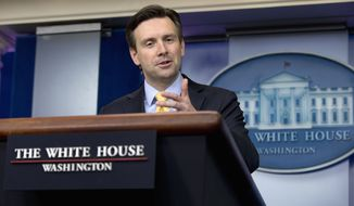White House press secretary Josh Earnest speaks during the daily news briefing at the White House in Washington, Tuesday, Dec. 15, 2015. Earnest discussed the anonymous email threat that closed all Los Angeles schools, and other topics.  (AP Photo/Carolyn Kaster)