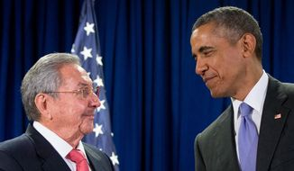 U.S. President Barack Obama stands with Cuba's President Raul Castro before a bilateral meeting at the United Nations headquarters on Sept. 29, 2015. (Associated Press) **FILE**
