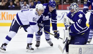 Toronto Maple Leafs' goalie Jonathan Bernier(45) makes a save on Tampa Bay Lightning's Valtteri Filppula (51), of Finland, during the third period of an NHL hockey game in Toronto, Tuesday, Dec. 15, 2015. (Frank Gunn/The Canadian Press via AP) MANDATORY CREDIT