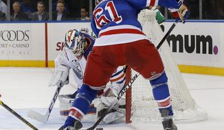 New York Rangers left wing Rick Nash (61) takes the rebound on his first shot and scores on Edmonton Oilers goalie Anders Nilsson (39) during the second period of an NHL hockey game, Tuesday, Dec. 15, 2015, in New York. (AP Photo/Julie Jacobson)