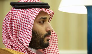"""Saudi Arabian Deputy Crown Prince Mohammed bin Salman listens in the Oval Office of the White House in Washington, during a meeting between Saudi Arabian Crown Prince Mohammed bin Nayef and President Barack Obama, in this May 13, 2015, file photo. Saudi Arabia said Tuesday, Dec. 15, that 34 nations have agreed to form a new """"Islamic military alliance"""" to fight terrorism with a joint operations center based in the kingdom's capital, Riyadh. (AP Photo/Jacquelyn Martin, File)"""