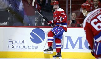 Washington Capitals center Michael Latta (46) celebrates his goal during the first period of an NHL hockey game against the Ottawa Senators, Wednesday, Dec. 16, 2015, in Washington. (AP Photo/Alex Brandon)