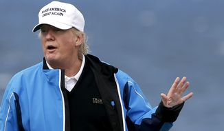 U.S. presidential contender Donald Trump poses for the media during the third day of the Women's British Open golf championship on his Turnberry golf course in Turnberry, Scotland, on Aug. 1, 2015. (Associated Press) **FILE**