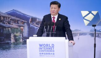 Chinese President Xi Jinping delivers a keynote speech at the opening ceremony of the Second World Internet Conference in Wuzhen Town, east China's Zhejiang Province, Wednesday, Dec. 16, 2015. (Chinatopix via AP) CHINA OUT