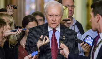 """Sen. Orrin G. Hatch, a Utah Republican who, as chairman of the Senate Committee on Finance, helped strike the deal to postpone the medical device tax, said they'll be back to finish it off. """"It's only for two years, but we're going to ultimately get rid of it completely,"""" he said. (Associated Press)"""