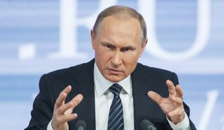 Russian President Vladimir Putin gestures during his annual news conference in Moscow, Russia, Thursday, Dec. 17, 2015. President Vladimir Putin says Turkey acted contrary to its own interests by downing a Russian warplane. Speaking at a televised news conference Thursday, Putin said that he sees no possibility of overcoming the diplomatic strain under the current Turkish leadership. (AP Photo/Alexander Zemlianichenko)