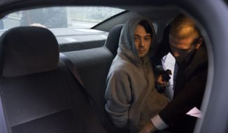 Martin Shkreli, the former hedge fund manager under fire for buying a pharmaceutical company and ratcheting up the price of a life-saving drug, is belted into an awaiting car after being taken into custody following a securities probe, on Thursday, Dec. 17, 2015 in New York. A seven-count indictment unsealed in Brooklyn federal court Thursday charged Shkreli with conspiracy to commit securities fraud, conspiracy to commit wire fraud and securities fraud. (AP Photo/Craig Ruttle)