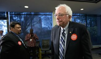 Democratic presidential candidate Sen. Bernie Sanders, I-Vt., leaves a news conference where he was endorsed by members of the Communication Workers of America (CWA), Thursday, Dec. 17, 2015, at the CWA's headquarters in Washington. (AP Photo/Manuel Balce Ceneta)