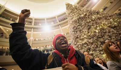In this Dec. 20, 2014 photo, Janerio Taylor, of Minneapolis, chants with other demonstrators during a Black Lives Matter protest at the Mall of America rotunda in Bloomington, Minn. The Minneapolis chapter of Black Lives Matter is planning to rally later in December 2015 at the mall to protest the November killing of Jamar Clark, a black man by Minneapolis police. (Aaron Lavinsky/Star Tribune via AP) MANDATORY CREDIT