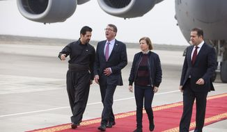 U.S. Defense Secretary Ash Carter, second left, is welcomed by Deputy Prime Minister of the Kurdish Regional Government (KRG) Qubad Talabani, left, on arrival in Irbil, northern Iraq, Thursday, Dec. 17, 2015. Carter is visiting with Kurdish president Massoud Barzani as well as U.S. troops to discuss the fight against the Islamic State group. (AP Photo/Seivan M.Salim)