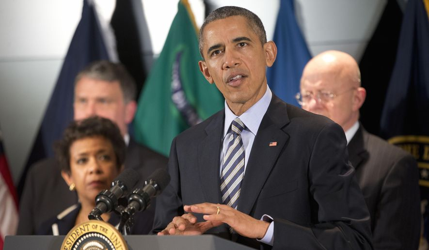 President Barack Obama speak at the National Counterterrorism Center in McLean, Va., on Dec. 17, 2015. Joining him are (from left) National Counterterrorism Center Director Nicholas Rasmussen, Attorney General Loretta Lynch and Office of National Intelligence Director James Clapper. (Associated Press) **FILE**