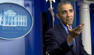 President Barack Obama gestures as he speaks during a news conference in the Brady Press briefing room at the White House, in Washington, Friday, Dec. 18, 2015. (AP Photo/Carolyn Kaster)