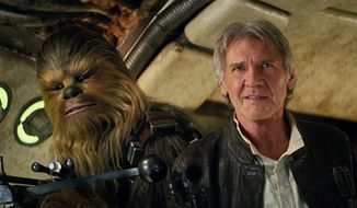 "This photo provided by Lucasfilm shows Peter Mayhew as Chewbacca and Harrison Ford as Han Solo in ""Star Wars: The Force Awakens,"" directed by J.J. Abrams. Lawrence Kasdan co-wrote the screenplay with Abrams. The movie opens in U.S. theaters on Friday, Dec. 18, 2015. (Film Frame/Lucasfilm via AP) -"