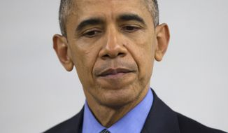 President Barack Obama delivers a statement at Indian Springs High School after meeting with families affected by the mass shooting in San Bernardino, Calif., on Friday, Dec. 18, 2015, in San Bernardino. (AP Photo/Evan Vucci)