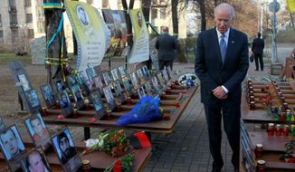 "Vice President Joseph R. Biden paid his respects in honor of the ""Heavenly Hundred"" during a ceremony at the monument dedicated to them in Kiev, Ukraine, on Dec. 7. The ""Heavenly Hundred"" is what Ukrainians call those who died during months of anti-government protests two years ago that ended in new leadership but not much change. (Associated Press)"