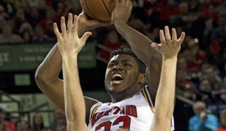 Maryland's Diamond Stone (33) goes to the basket as Princeton's Spencer Weisz(10) tries to block during the second half of an NCAA college basketball game at Royal Farms Arena in Baltimore, Saturday, Dec. 19, 2015. (AP Photo/Jose Luis Magana)